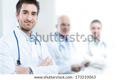Professional doctor at hospital with crossed arms