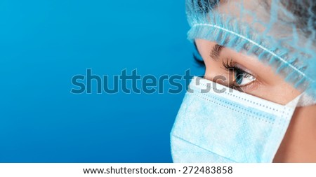Professional doctor at work blue background - stock photo