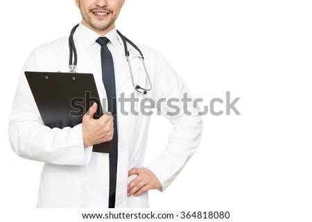 Professional doctor. Cropped shot of a handsome doctor checking medical results on his clipboard smiling happily copyspace on the side - stock photo