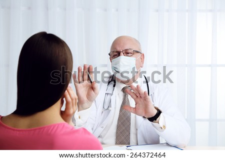 Professional doctor receiving patient in his office on white curtain background