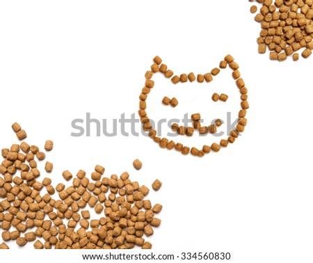 Professional dry cat food forming smiling cat face and heaps in the corners, horizontal format. Healthy organic pet food isolated over white. - stock photo