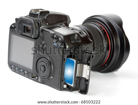 Professional DSLR camera with inserted memory card. Close up with shallow DOF. - stock photo