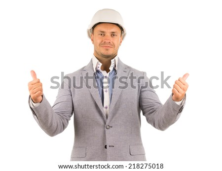 Professional engineer or manager wearing white hardhat while showing thumbs up or pointing upwards, portrait on white - stock photo