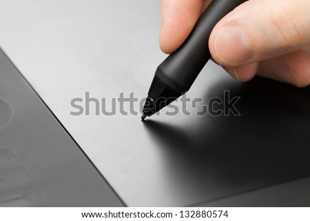 Professional graphic tablet with pen - stock photo