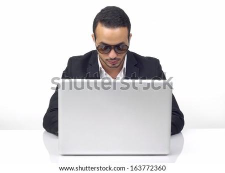 Professional hacker working on laptop  - stock photo