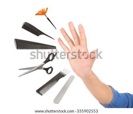 Professional hairdresser and make up tools get out of hand isolated on white