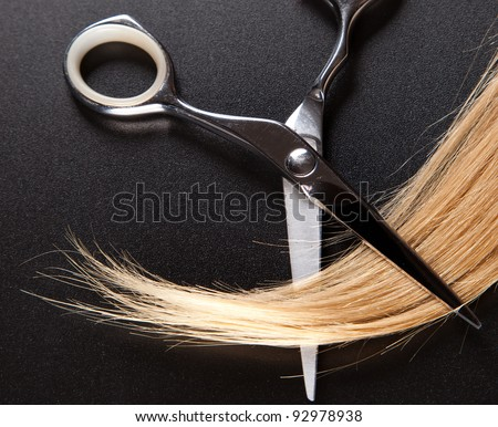 professional hairdresser scissors on  dark background - stock photo