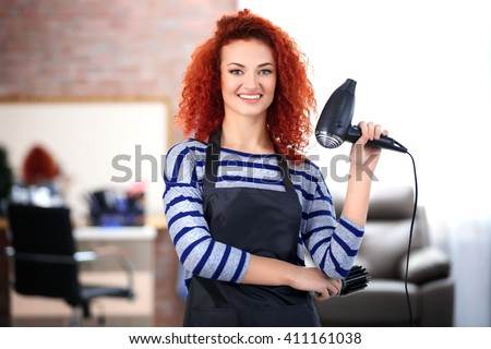 Professional hairdresser with hairdryer - stock photo