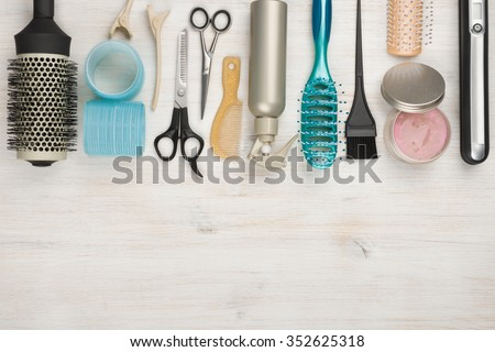 Professional hairdressing tools and accessories with copyspace at the bottom - stock photo