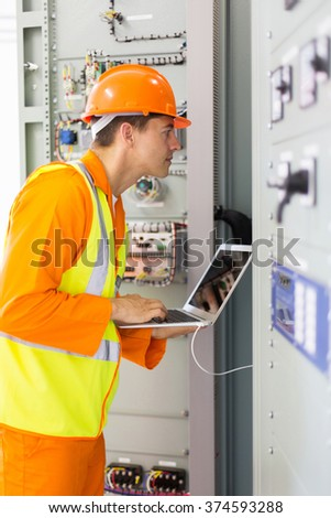 professional industrial technician checking transformer