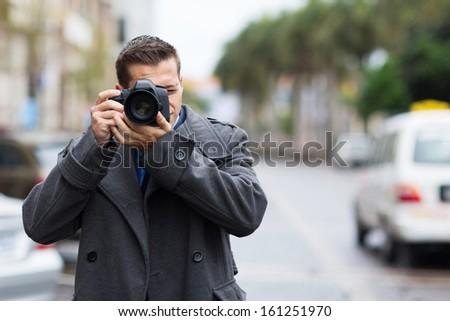 professional journalist taking photos outdoors - stock photo