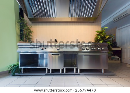 Professional kitchen in modern building closeup photo - stock photo