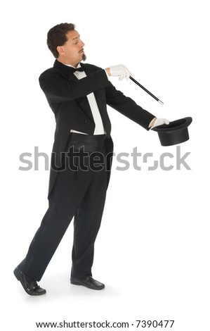 Professional magician wearing tuxedo performing on a white background - stock photo