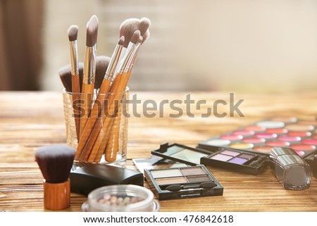 Professional make-up accessories on table