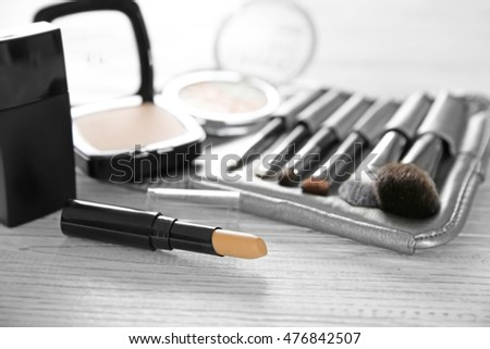 Professional make-up accessories on wooden table