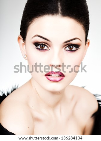 professional  make-up and hairstyle on beautiful woman face - studio beauty shot - stock photo