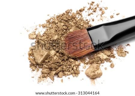 Professional make-up brush on  crushed eyeshadow - stock photo