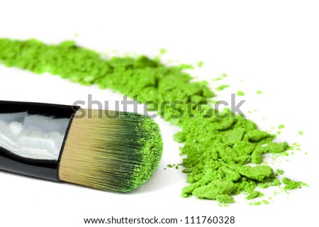 Professional make-up brush on green crushed eyeshadow - stock photo