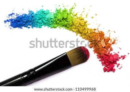Professional make-up brush on rainbow crushed eyeshadow - stock photo