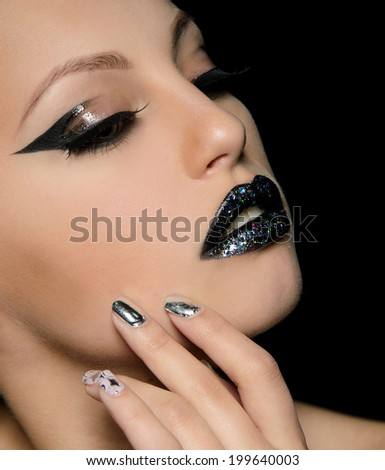 professional make-up on face of young girl on black background
