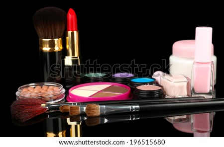 Professional make-up tools on black background - stock photo