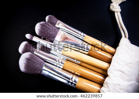 Professional makeup brushes collection on black background