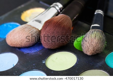 Professional makeup brushes, colorful palette, natural bristle