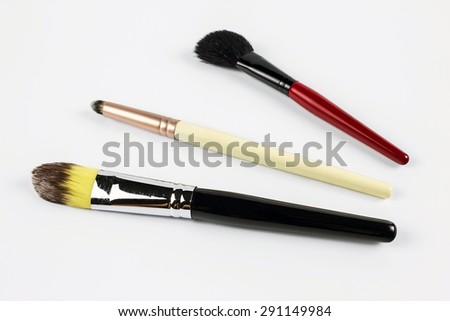 Professional makeup brushes on a white background - stock photo