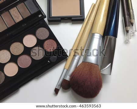 Professional makeup cosmetics on white background.