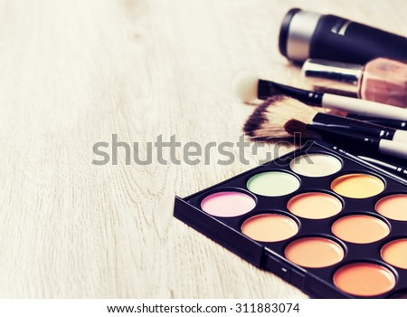 Professional makeup palette, makeup brushes, makeup products  with copyspace (Toning, instagram filter) - stock photo