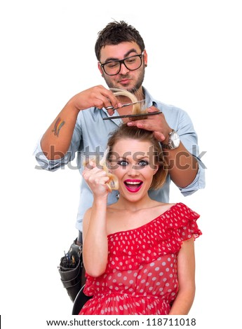 Professional male hairdresser, make hairstyle from woman, isolated on white - stock photo