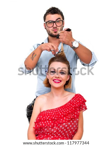 Professional male hairdresser making a hairstyle from blond woman, isolated on white