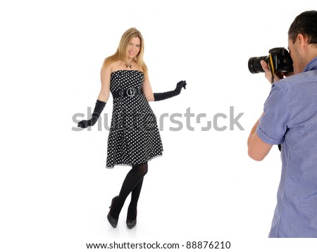 professional male photographer at studio fashion shot with a model