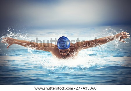 Professional man swimmer swims in open sea - stock photo