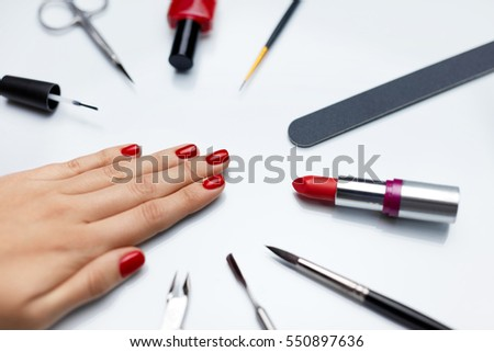 Professional Manicure Closeup Of Beautiful Womans Nails With Red Nail Polish Care Tools