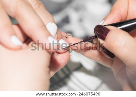 professional manicure in a beauty salon - stock photo