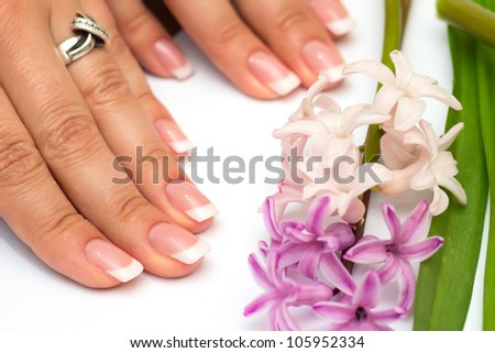 Professional manicure nails on white background with flowers