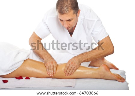 Professional masseur giving anti cellulite leg massage to a woman at spa resort - stock photo