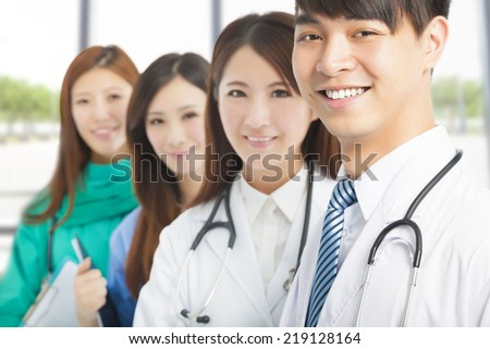 Professional medical doctor team standing in office - stock photo