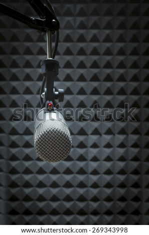Professional microphone in a recording studio - stock photo