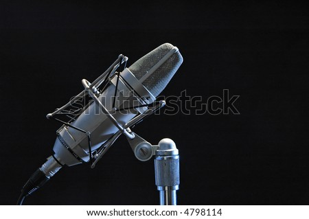 Professional microphone isolated on black - stock photo