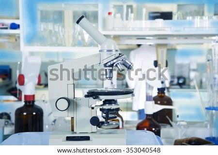 Professional microscope close-up with in the laboratory interior. - stock photo