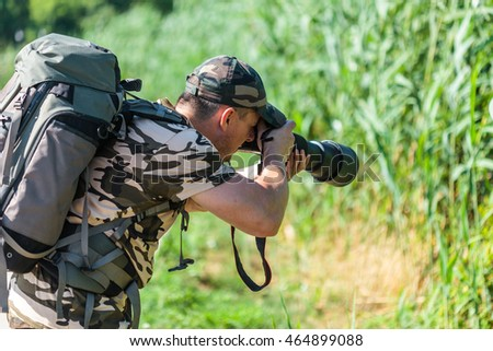 Professional nature and wildlife photographer at work