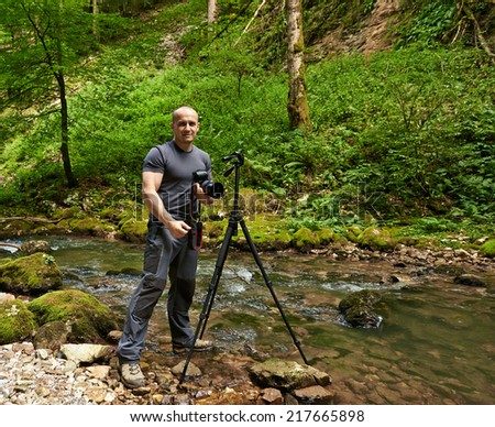 Professional nature photographer shooting landscapes in a canyon, from a tripod