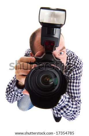 Professional photographer making the shoot. Isolated on white