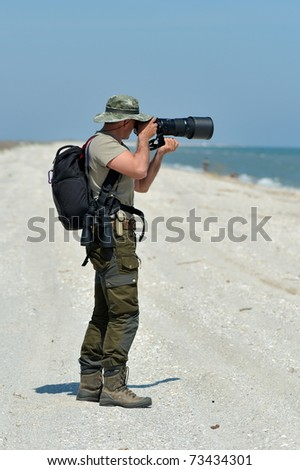 professional photographer outdoor - stock photo