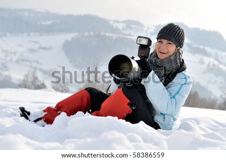 professional photographer outdoor in winter - stock photo