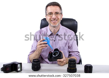 Professional photographer showing how to use camera gear.  He is isolated on a white background. - stock photo