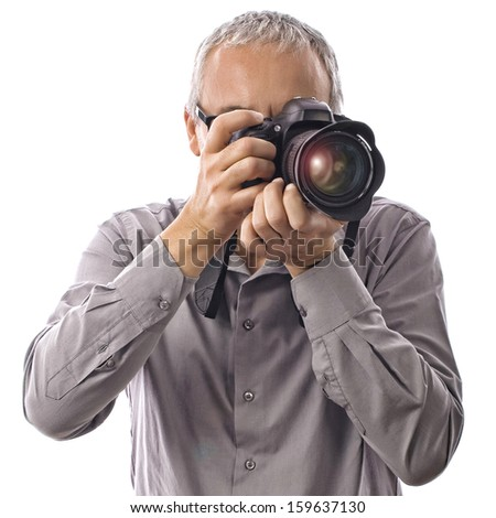 Professional photographer taking pictures with camera on white - stock photo