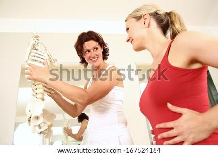 Professional physiotherapist explaining the thorax - stock photo